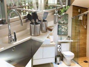 Arte gráfica mostrando uma pia de cozinha e um banheiro